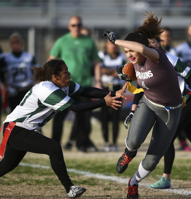 Cimarron-Memorial's Logan DeLong (4) runs the ball past Palo Verde's Madison Hearn (80) during the Sunset Region flag football championship game at Green Valley High School in Henderson on Tuesday ...