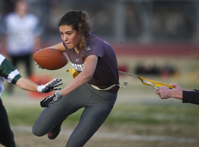 Cimarron-Memorial's Haylie Hughes (18) is tagged by  Palo Verde during the Sunset Region flag football championship game at Green Valley High School in Henderson on Tuesday, Feb. 21, 2017. Cimarro ...
