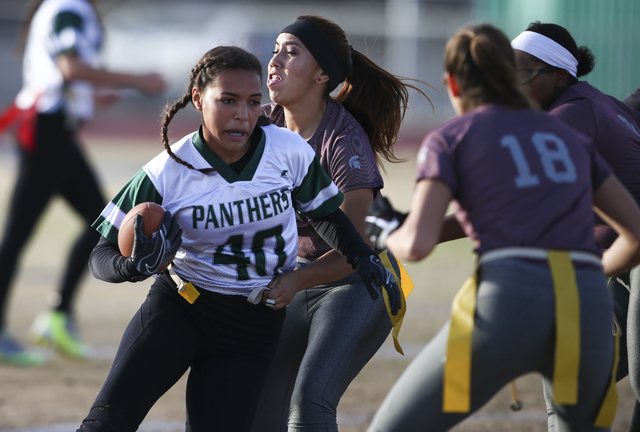 Palo Verde's Mya Boykin (40) runs the ball against Cimarron-Memorial during the Sunset Region flag football championship game at Green Valley High School in Henderson on Tuesday, Feb. 21, 2017. Ci ...