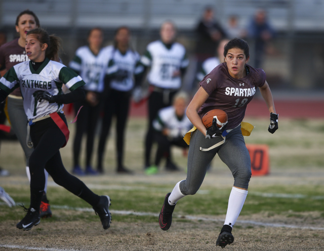 Cimarron-Memorial's Haylie Hughes (18) runs the ball against Palo Verde during the Sunset Region flag football championship game at Green Valley High School in Henderson on Tuesday, Feb. 21, 2017. ...
