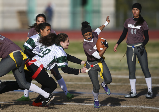 Cimarron-Memorial's Catherine Jovan (2) is tagged by Palo Verde's Grace Cashin (59) during the Sunset Region flag football championship game at Green Valley High School in Henderson on Tuesday, Fe ...