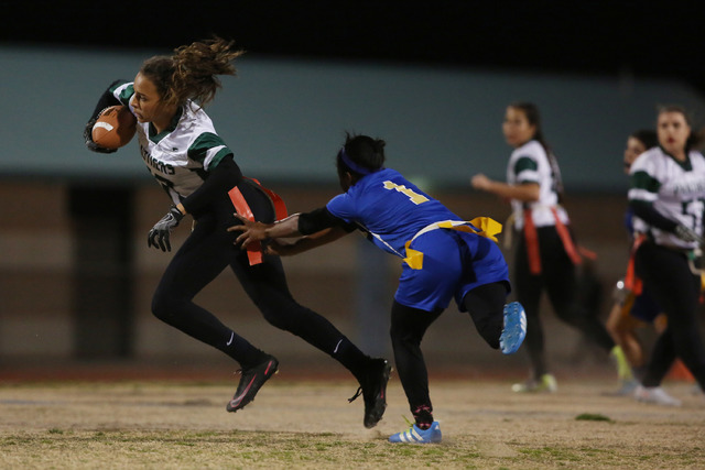 Palo Verde sophomore Mya Boykin attempts to run the ball as Sierra Vista junior Courtney O'Neal reaches for her flags at Sierra Vista High School on Thursday, Feb. 16, 2017, in Las Vegas. Palo Ver ...