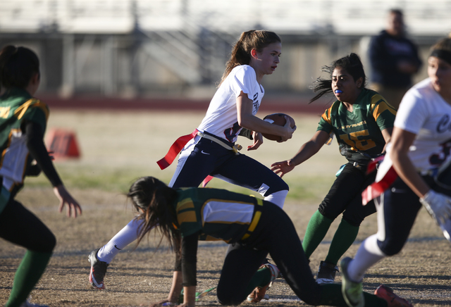Coronado's Caitlin Shannon (9) runs the ball against Rancho during a flag football game at Green Valley High School in Henderson on Tuesday, Feb. 14, 2017. Coronado won 41-6. (Chase Stevens/Las Ve ...