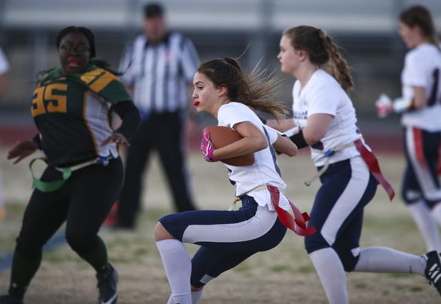 Coronado's Brittany Whitt (8) runs the ball against Rancho during a flag football game at Green Valley High School in Henderson on Tuesday, Feb. 14, 2017. Coronado won 41-6. (Chase Stevens/Las Veg ...