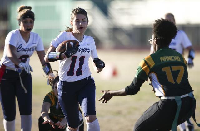 Coronado's Trinity Rhoades (11) runs the ball against Rancho during a flag football game at Green Valley High School in Henderson on Tuesday, Feb. 14, 2017. Coronado won 41-6. (Chase Stevens/Las V ...