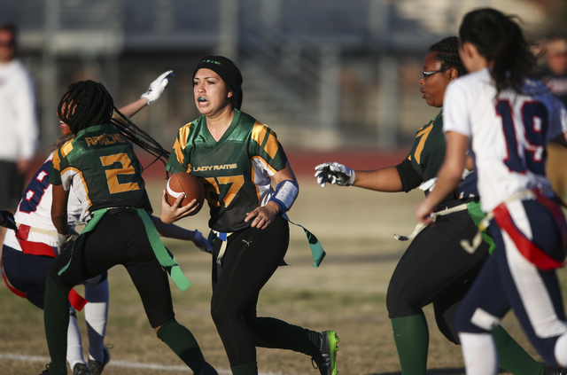 Rancho's Katerina Anthony (27) runs the ball against Coronado during a flag football game at Green Valley High School in Henderson on Tuesday, Feb. 14, 2017. Coronado won 41-6. (Chase Stevens/Las  ...