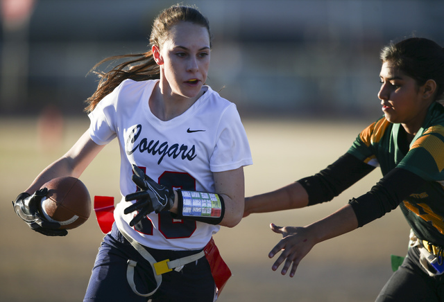 Coronado's Reagan Raimer (10) tries evade Rancho's Zulma Flores (4) during a flag football game at Green Valley High School in Henderson on Tuesday, Feb. 14, 2017. Coronado won 41-6. (Chase Steven ...