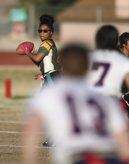 Rancho's Kayla Holbert (1) looks to pass the ball during a flag football game against Coronado at Green Valley High School in Henderson on Tuesday, Feb. 14, 2017. Coronado won 41-6. (Chase Stevens ...