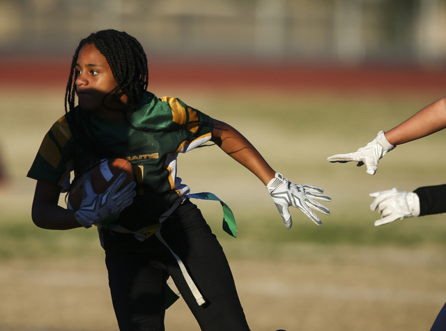 Rancho's Talaya Williams (2) runs the ball against Coronado during a flag football game at Green Valley High School in Henderson on Tuesday, Feb. 14, 2017. Coronado won 41-6. (Chase Stevens/Las Ve ...