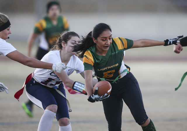 Rancho's Christina Parada (6) is tagged out by Coronado's Shawna Slater (3), far left, and Trinity Rhoades (11) during a flag football game at Green Valley High School in Henderson on Tuesday, Feb ...