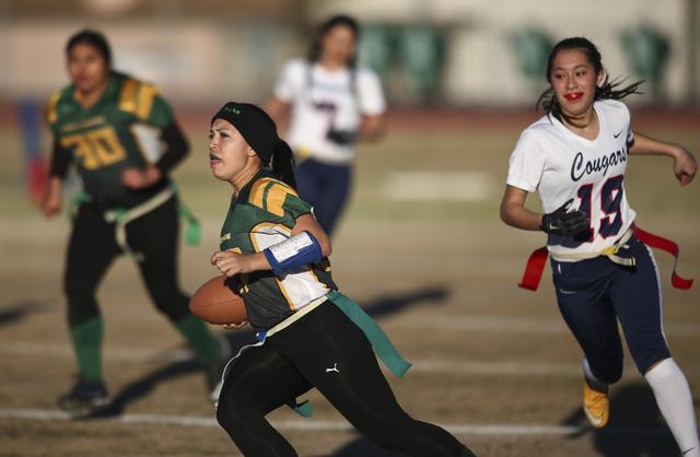 Rancho's Katerina Anthony (27) runs the ball past Coronado's Sofia Herrera (19) during a flag football game at Green Valley High School in Henderson on Tuesday, Feb. 14, 2017. Coronado won 41-6. ( ...