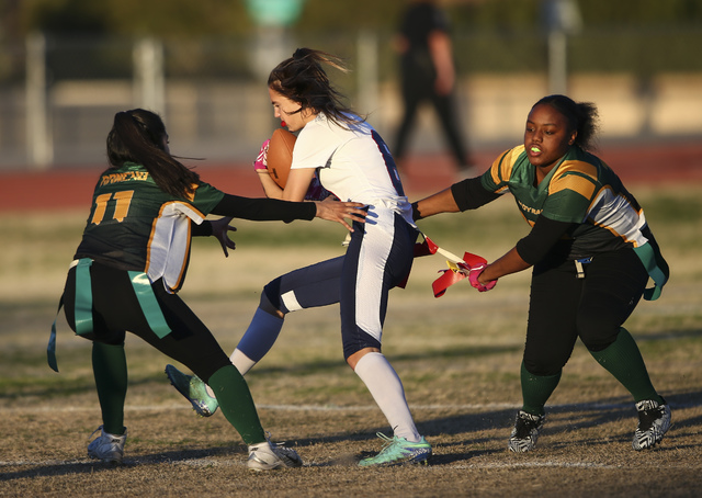 Coronado's Brittany Whitt (8) is tagged out by Rancho players, including Marina Cruz (11), during a flag football game at Green Valley High School in Henderson on Tuesday, Feb. 14, 2017. Coronado  ...