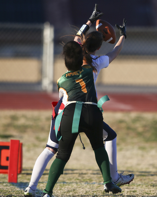 Coronado's Reagan Raimer (10) reels in a touchdown as Rancho's Kayla Holbert (1) defends during a flag football game at Green Valley High School in Henderson on Tuesday, Feb. 14, 2017. Coronado wo ...