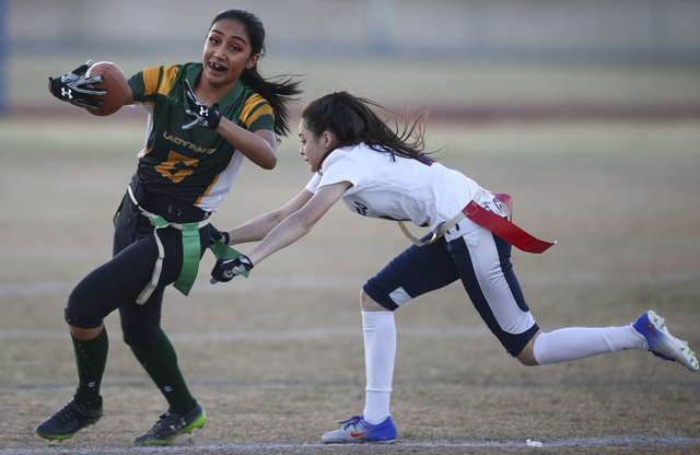 Rancho's Christina Parada (6) is tagged out by Coronado's Lexie Potts (4) during a flag football game at Green Valley High School in Henderson on Tuesday, Feb. 14, 2017. Coronado won 41-6. (Chase  ...