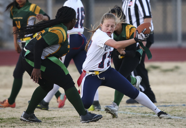 Coronado's Sydnee Hansen (17) is tagged out by Rancho players during a flag football game at Green Valley High School in Henderson on Tuesday, Feb. 14, 2017. Coronado won 41-6. (Chase Stevens/Las  ...