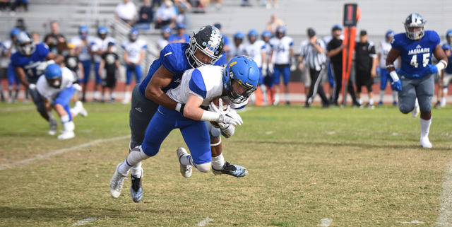 Desert Pines Tony Fields (1) tackles South Tahoe's Dylan Gooding (4) during their 3A state semifinal football game played at the Desert Pines football field in Las Vegas on Saturday, Nov. 12, 2016 ...