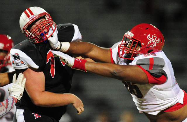 Arbor View defensive tackle Greg Rogers, right, battles Brendon Sandoval in the first half of their prep football game at Liberty High School in Henderson, Friday Aug. 26, 2016. Josh Holmberg/Las  ...