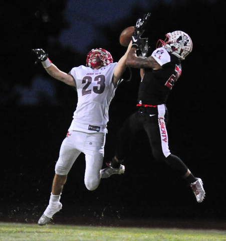 Arbor View defensive back Deago Stubbs breaks up a pass intended for Liberty wide receiver Darion Acohido in the first half of their prep football game at Liberty High School in Henderson, Friday  ...