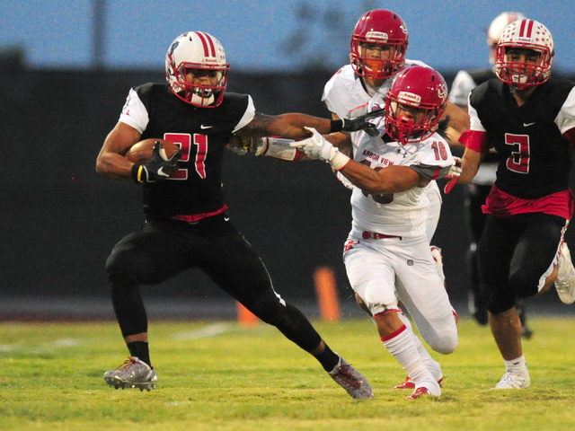 Liberty wide receiver Darion Acohido, left, fends off Arbor View safety Phenix Calinao in the first half of their prep football game at Liberty High School in Henderson, Friday Aug. 26, 2016. Josh ...