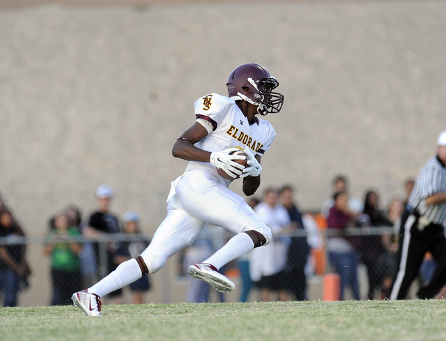 "Eldorado kick returner Joshua Brown returns the opening kickoff 96 yards for a touchdown against Chaparral on Friday. The Sundevils rallied for a 28-21 win in the annual ""Cleat Game."" (Josh Holmbe ..."