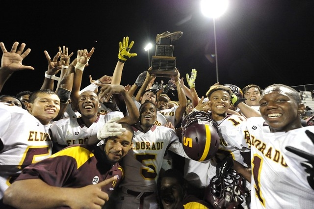 Eldorado players hoist the Cleat trophy after defeating the Chaparral Cowboys 28-21 on Friday. (Josh Holmberg/Las Vegas Review Journal)