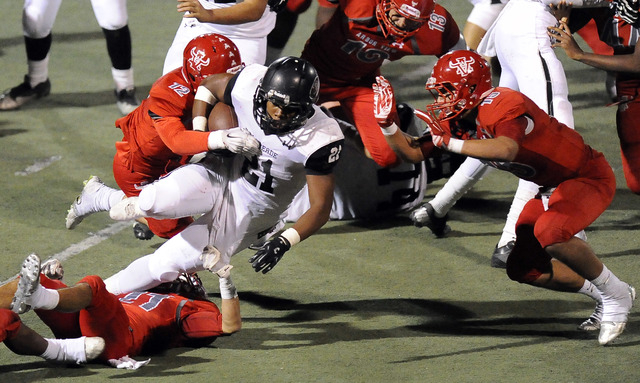 Arbor View linebacker Noah Noce (12) and defensive back Bryce Poster (15) tackle Palo Verde running back Jaren Campbell (21) on Firday. Arbor View defeated Palo Verde, 24-7. (Josh Holmberg/Las Veg ...