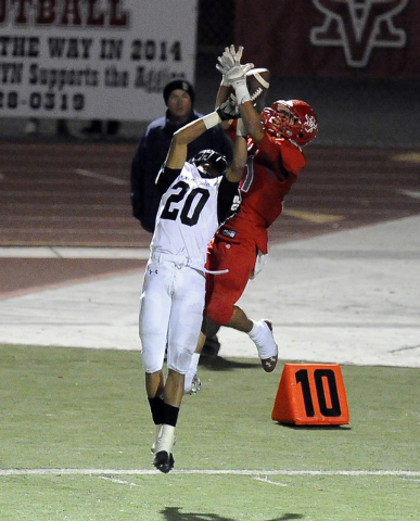 Arbor View defensive back Charles Louch (21) intercepts a pass intended for Palo Verde running back Isaac Woods (20) on the final play of the first half on Friday. Arbor View defeated Palo Verde 2 ...
