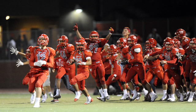 Arbor View players celebrate their 27-7 win over Palo Verde in Sunset Region semifinals on Friday. (Josh Holmberg/Las Vegas Review-Journal)