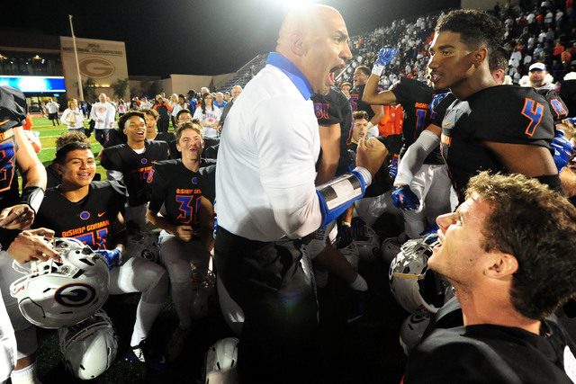 Bishop Gorman head coach Kenny Sanchez and players celebrate their 30-16 win over Don Bosco Prep after their prep football game at Bishop Gorman High School in Las Vegas Friday Oct. 23, 2015. Josh ...