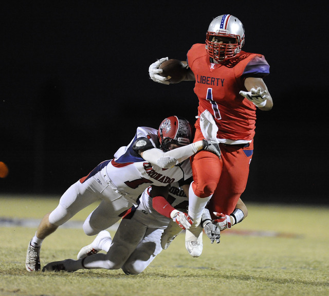 Coronado safety Koy Harris (1) and strong safety Jad Cheetany, right, tackle Liberty tight end Noah Jefferson in the first quarter on Friday. (Josh Holmberg/Las Vegas Review-Journal)