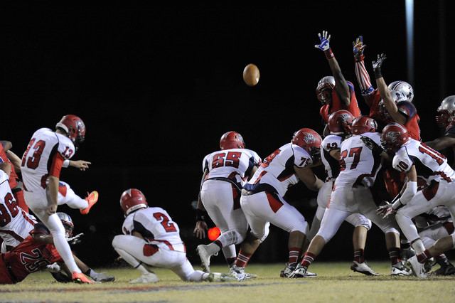Liberty defenders attempt to block Spencer Cofer's game-winning field goal attempt on Friday night. (Josh Holmberg/Las Vegas Review-Journal)