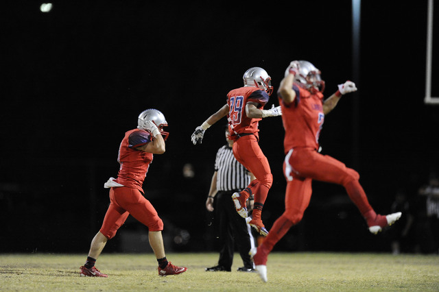 Liberty players celebrate after Coronado's game-winning field goal attempt missed as time expired on Friday, allowing the Patriots to escape with a 14-13 win. (Josh Holmberg/Las Vegas Review-Journal)