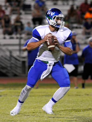 Green Valley quarterback Christian Lopez drops back to pass on Friday against Palo Verde. Lopez threw a pair of TD passes. (Photo by David Becker/Las Vegas Review-Journal)