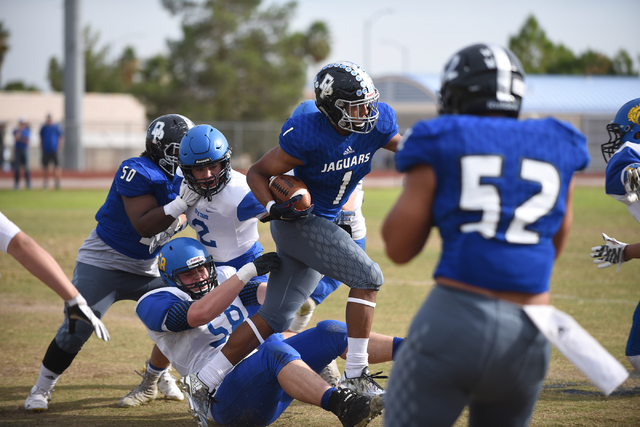 Desert Pines Tony Fields (1) runs the ball against South Tahoe during their 3A state semifinal football game played at the Desert Pines football field in Las Vegas on Saturday, Nov. 12, 2016. Dese ...