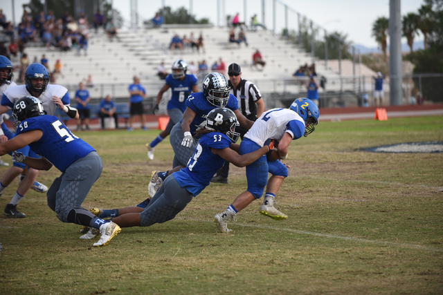 Desert Pines Lorenzo Brown (53) tackles South Tahoe's Jacob Costly (2) during their 3A state semifinal football game played at the Desert Pines football field in Las Vegas on Saturday, Nov. 12, 20 ...