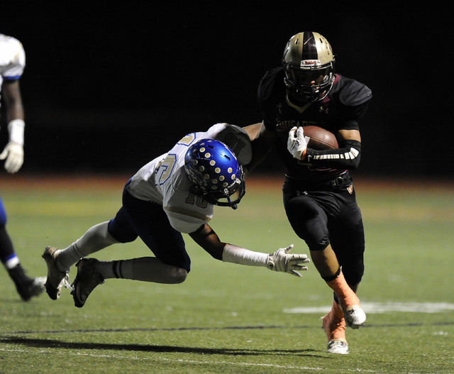 Sierra Vista safety Javion Hunt (16) goes to tackle Faith Lutheran's Christian Marshall (4) in the first half of their high school football game at Faith Lutheran High School in Las Vegas, NV Frid ...