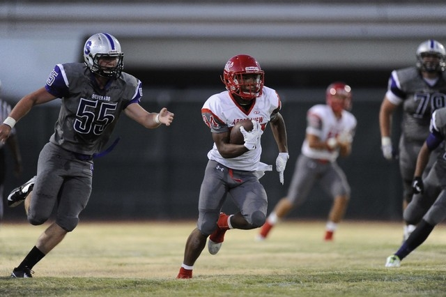Arbor View running back Herman Gray (34) rushes for a first down against Silverado in the first quarter on Friday. Josh Holmberg/Las Vegas Review-Journal)