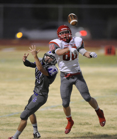 Arbor View linebacker Mitchell Durkee (88) breaks up a pass intended for Silverado wide receiver Matthew French (14) in the first quarter on Friday. (Josh Holmberg/Las Vegas Review-Journal)