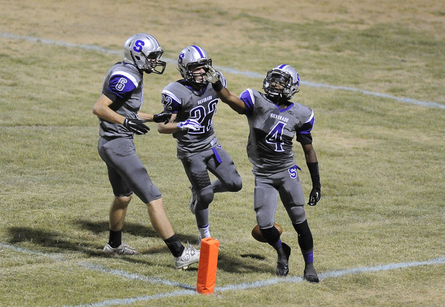 Silverado running back Deyon McKinney (4) celebrates a touchdown with teammates Robert Richardson (6) and Cyson Verville (22) in the second quarter on Friday. (Josh Holmberg/Las Vegas Review-Journal)