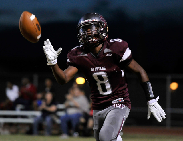 Cimarron-Memorial's Maurice Bennett tosses the ball after scoring on a 2-point conversion against Cheyenne on Friday. (David Becker/Las Vegas Review-Journal)