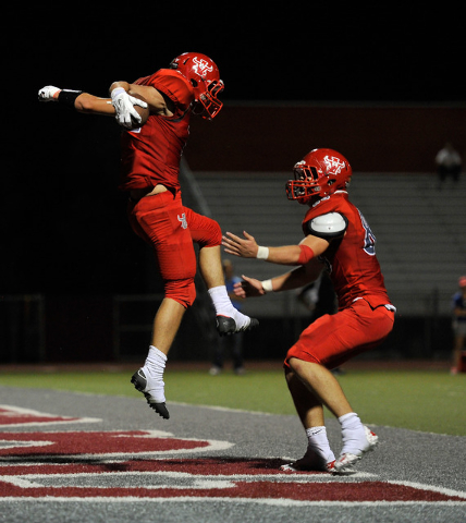 Arbor View's Noah Noce, left, celebrates a touchdown with teammate Mitchell Durkee during the first half on Friday. (David Becker/Las Vegas Review-Journal)