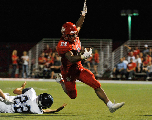 Arbor View's Herman Gray (34) breaks free from Canyon Springs' Kyle Stuart in the first half on Friday. Gray rushed for 126 yards and a touchdown in a 44-14 Arbor View victory.  (David Becker/Las  ...
