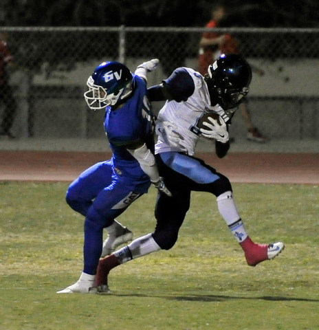 Canyon Springs' Kujuan Casey, right, runs in for a touchdown as Green Valley's Jacob Rivero tries to defend during the second quarter on Friday. (David Becker/Las Vegas Review-Journal)