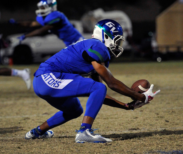 Green Valley's Isaiah Macklin reaches to make a catch against Canyon Springs on Friday. (David Becker/Las Vegas Review-Journal)