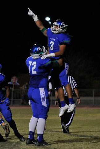 Green Valley's Brenan Adams (3) celebrates a first-quarter touchdown with Joel Salakielu on Friday. (David Becker/Las Vegas Review-Journal)