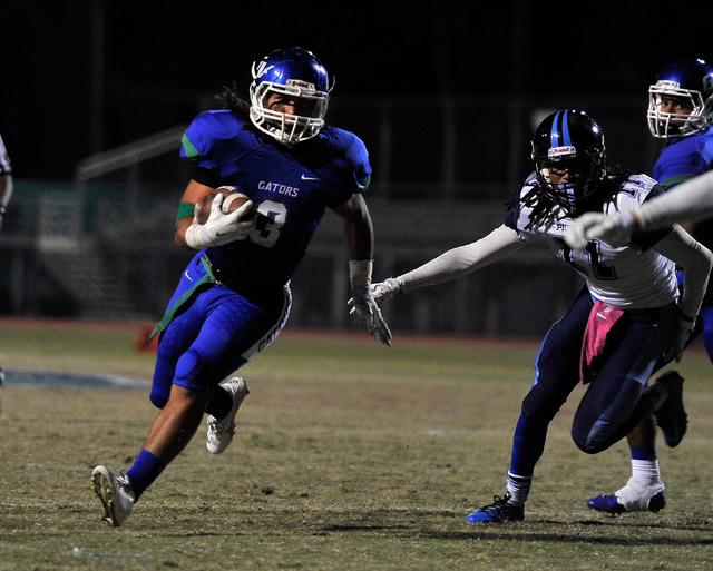 Green Valley's Brenan Adams (3) runs with the ball against Canyon Springs earlier this season. Adams will have to shoulder the load for the Gators with leading rusher Albert Lake out with a broken ...
