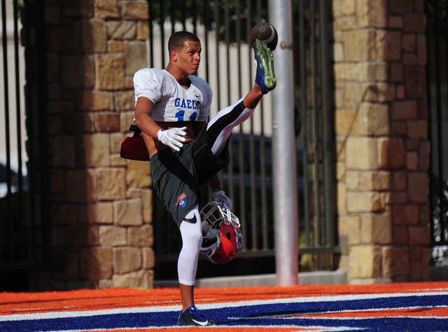 Bishop Gorman safety Bubba Bolden playfully punts a ball over a goal post during practice at Bishop Gorman High School in Las Vegas, Wednesday Aug. 31, 2016. Josh Holmberg/Las Vegas Review-Journal