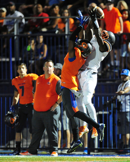 Cocoa, Fla., wide receiver Juwan Armstrong catches a first down pass while Bishop Gorman cornerback Alex Perry defends in the first half of their prep football game at Bishop Gorman High School in ...