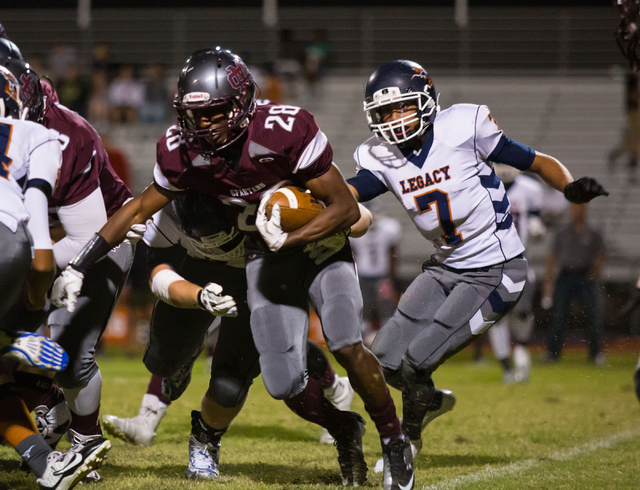 Cimarron-Memorial's Tyree Riley (28) runs the ball in the first half against Legacy on Saturday, Sept. 27, 2014. (Samantha Clemens-Kerbs/Las Vegas Review-Journal)