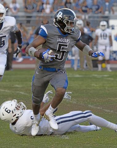 Desert Pines High School's Eddie Heckard (5) runs the ball upfield during a football game against Centennial high School at Desert Pines High School in Las Vegas, Friday, Aug. 26, 2016. Jason Ogul ...